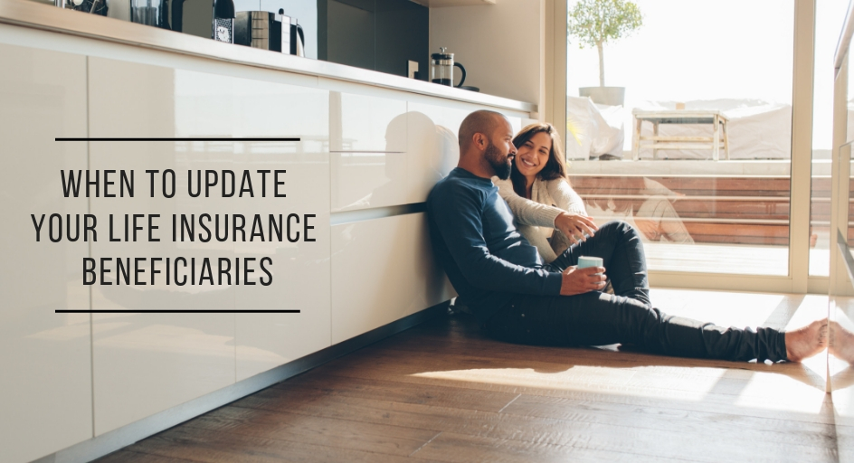 blog image of young couple sitting on the floor of their kitchen talking; blog title: When to Update Your Life Insurance Beneficiaries